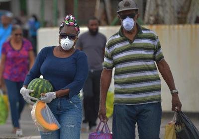Two buyers wear protective masks