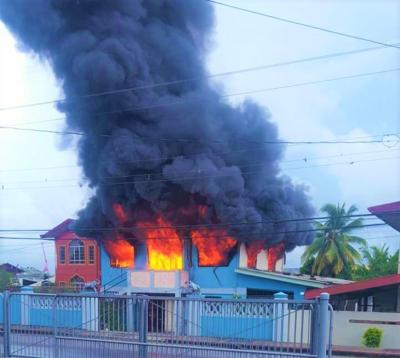 RAGING FIRE: The Singh family home ablaze yesterday at Felicity.