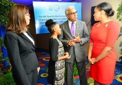 launch: Gretchen Camacho-Mohammed, from left, RBC Royal Bank managing director; Destiny; Health Minister Terrence Deyalsingh; and Sport Minister  Shamfa Cudjoe at the launch of RBC's Race for the Kids at the Hilton Trinidad  in Port of Spain. —Photo: stephen doobay