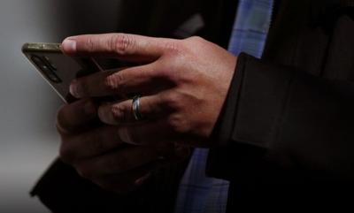 A man uses his mobile phone