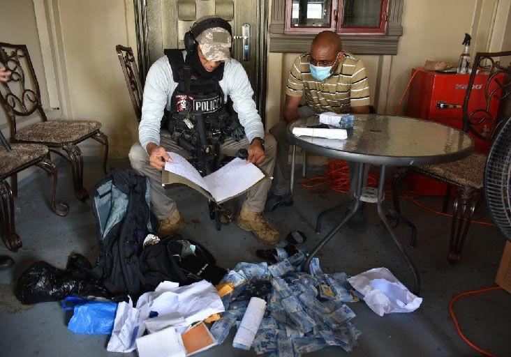 Police examine record books