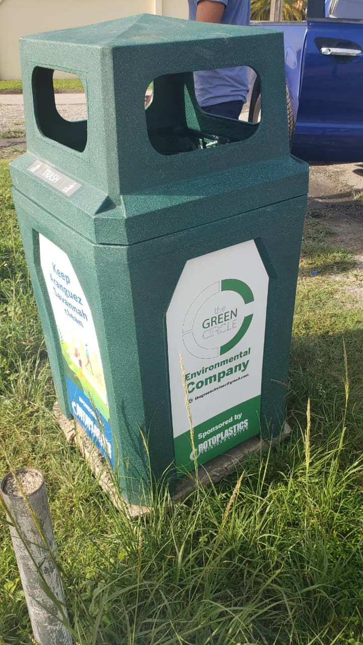 Garbage Bins for a cleaner Aranguez Savannah. These bins were installed on Saturday by members of the Green Circle Environmental Company, courtesy Rotoplastics
