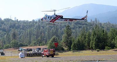 Cal Fire helicopter in the air over Trinity County