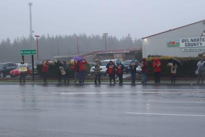 Teachers in rain