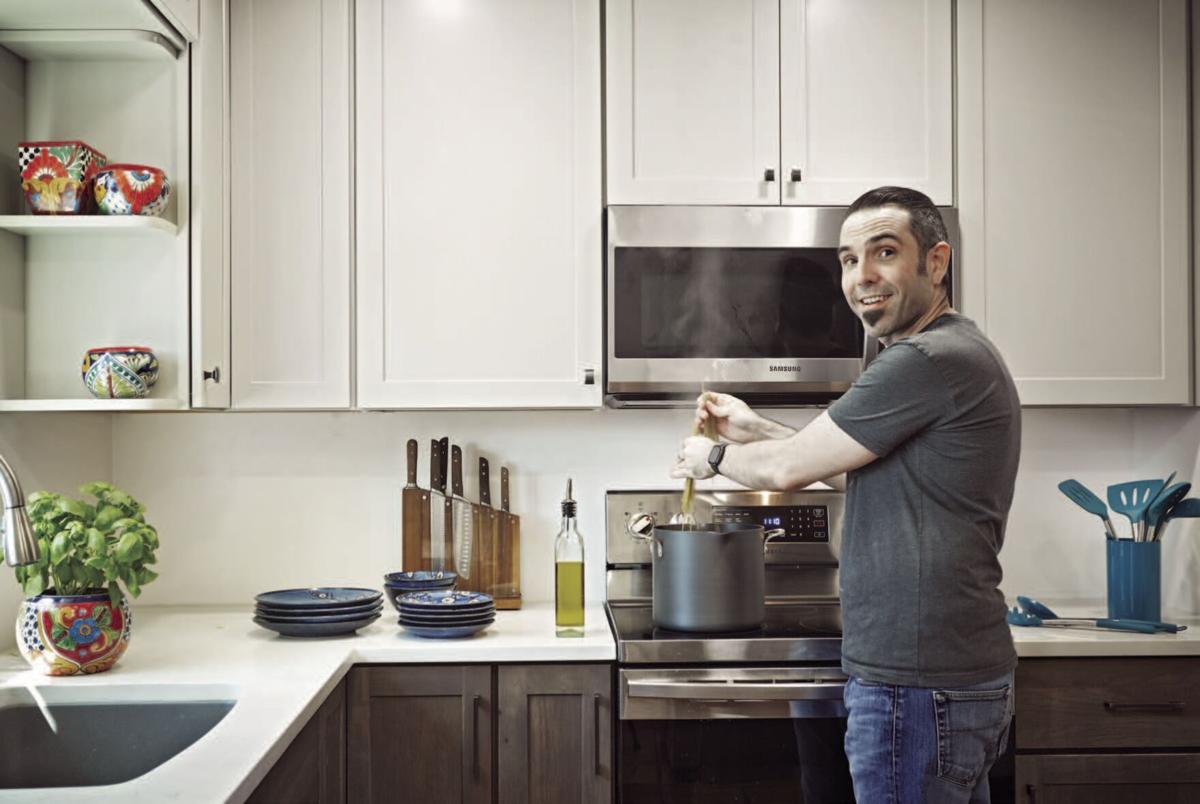 Matthew Choate in his kitchen .jpg