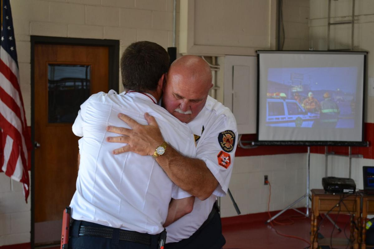 Stubbs and Chief hug.JPG