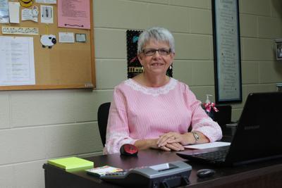 Linda Conner at desk