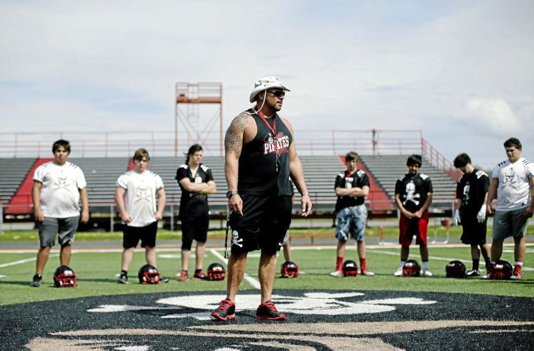 Coach Matt Hennesy speaks to his team