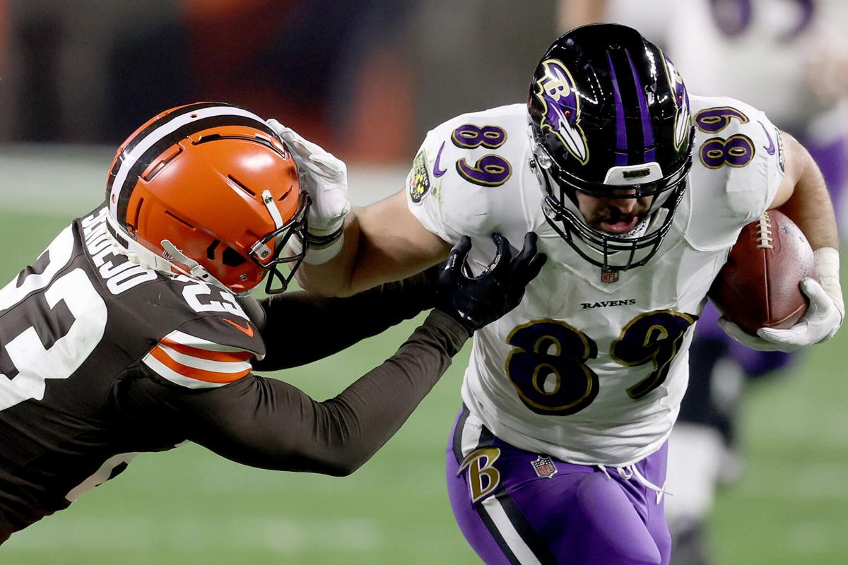 Baltimore Ravens tight end Mark Andrews, right, stiff-arms the Cleveland Browns' Andrew Sendejo during the second quarter in the game at FirstEnergy Stadium in Cleveland on December 14, 2020.