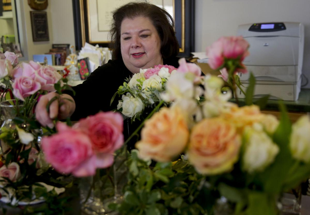 Toni Garner arranges flowers at Toni's Flowers and Gifts. MIKE SIMONS/Tulsa World