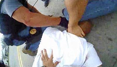 Eric Harris restrained