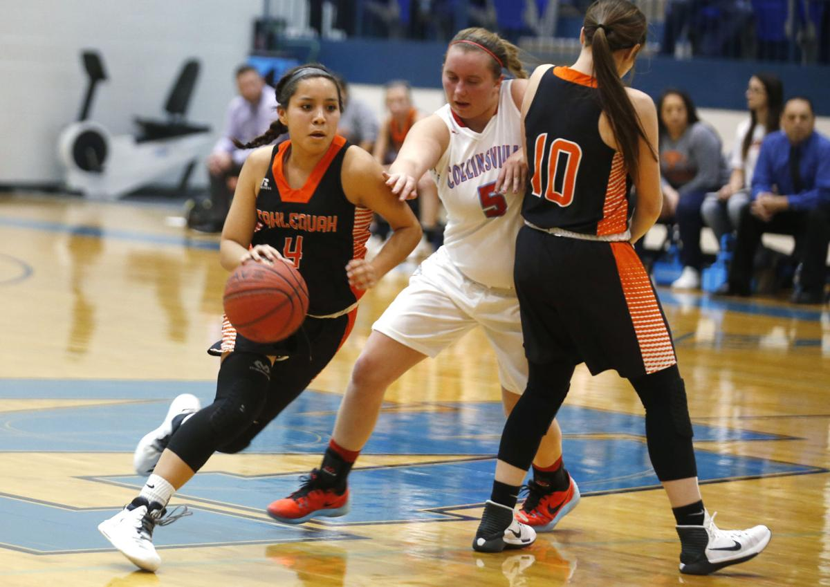 tahlequah girls Collinsville's mallory vaughn makes a move with tahlequah's sierra l smith defending during the class 5a girls area chmpionship game last friday.