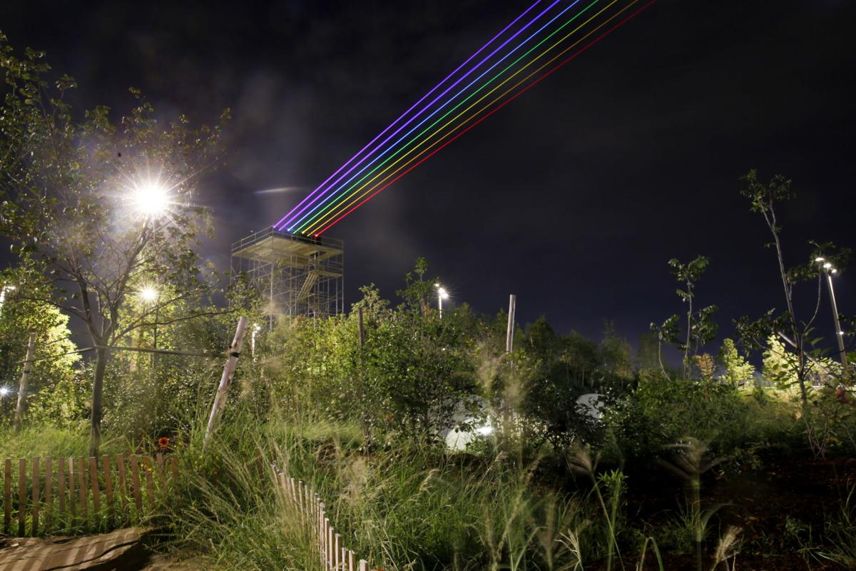 gathering place rainbow lasers wash over tulsa as a light for hope