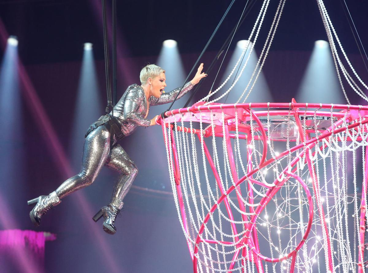 Part vocalist and part daredevil, Pink treats sold-out BOK