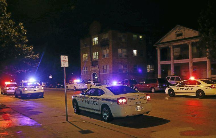 Police Patrol Cars Sit Near The Cheyenne Arms Apartments 1210 S Ave Late Monday After A Woman Was Found Bed To In Second Floor