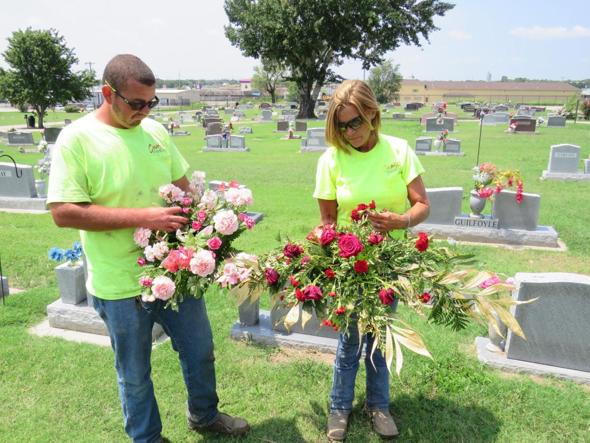 a solemn effort fairview cemetery groundskeepers work to beautify