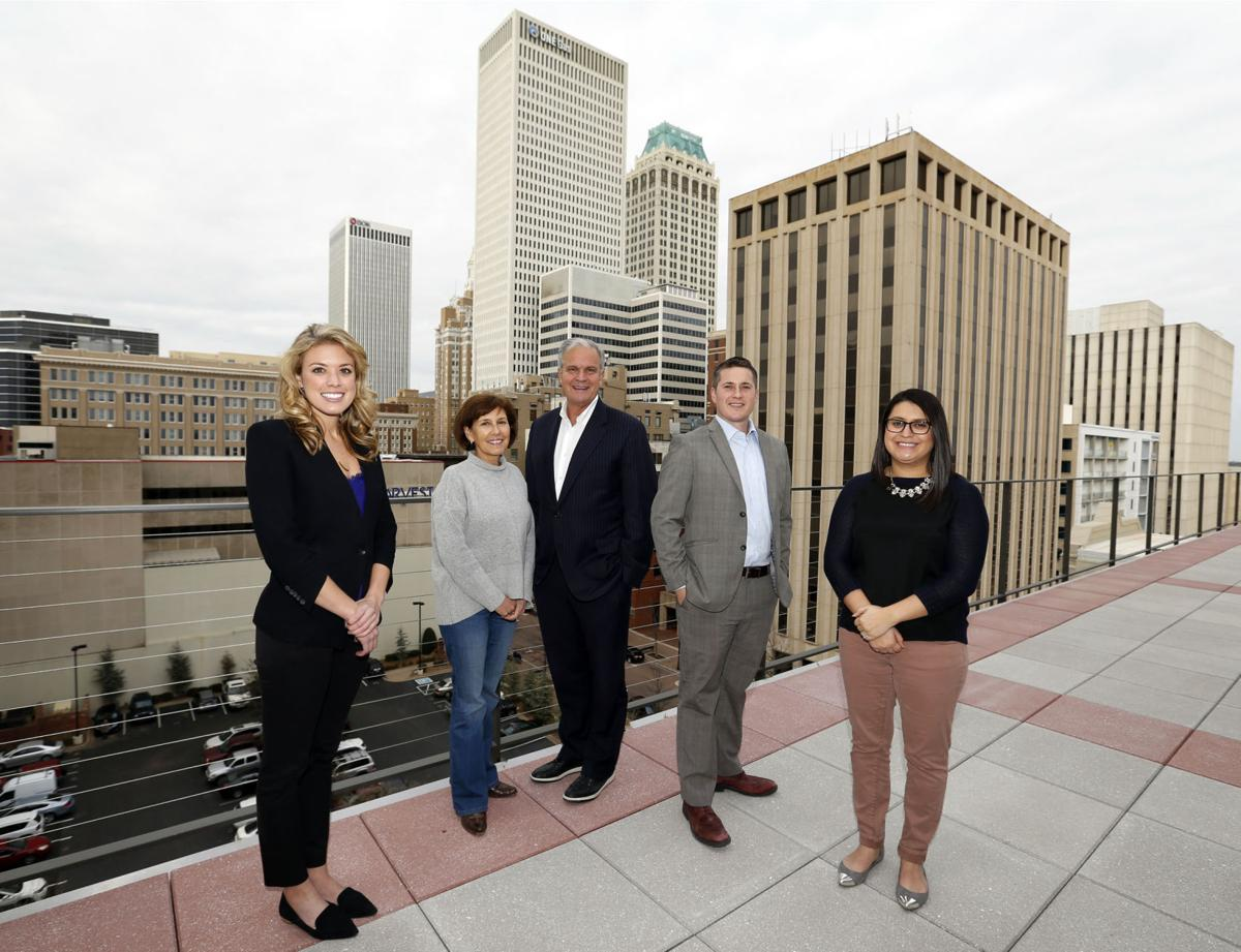 Tulsa Developer Stuart Price Center Stands On A Balcony Of The Art Deco Lofts Formerly Transok Building With His Executive Team Left Jackie