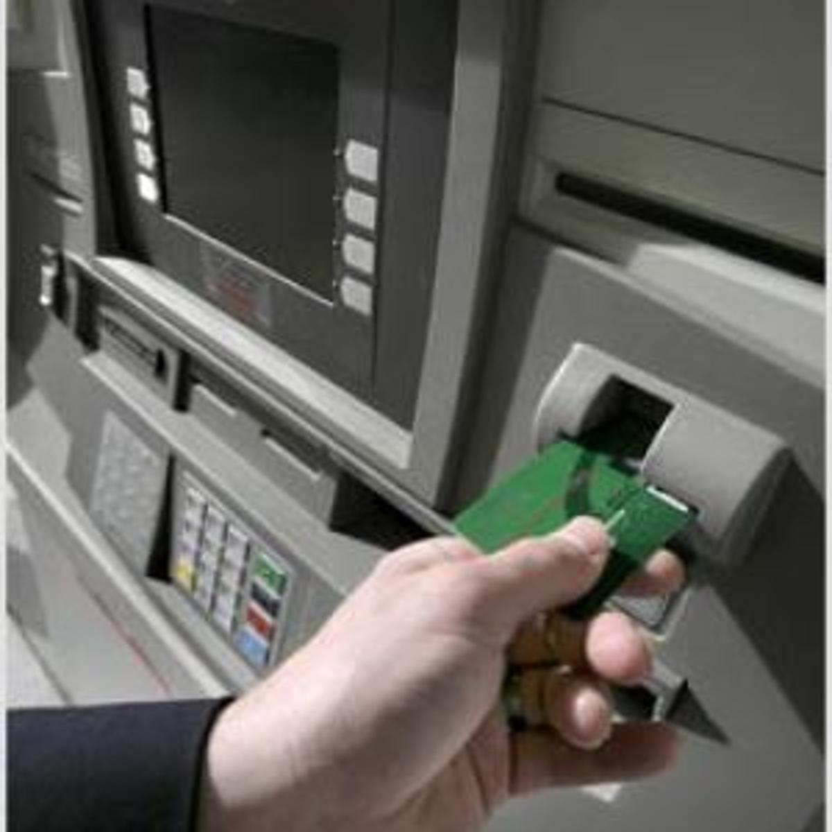 Service Choice: Fee or No Fee: ATMs boost banking | Archive