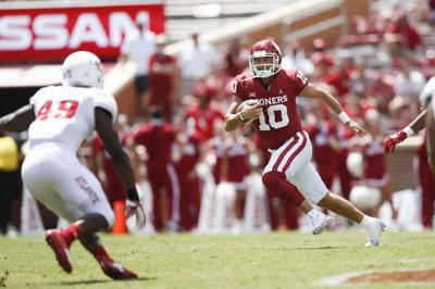 70e66cfcf34 Oklahoma Sooners quarterback Austin Kendall (10) scrambles for yards during  the NCAA football game between the Oklahoma Sooners and the Florida  Atlantic ...