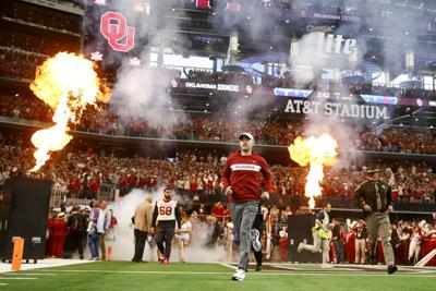 a41433b531a Oklahoma coach Lincoln Riley runs onto the field before the Big 12  Conference championship game against Texas at AT&T Stadium in Arlington,  Texas, Dec. 1.