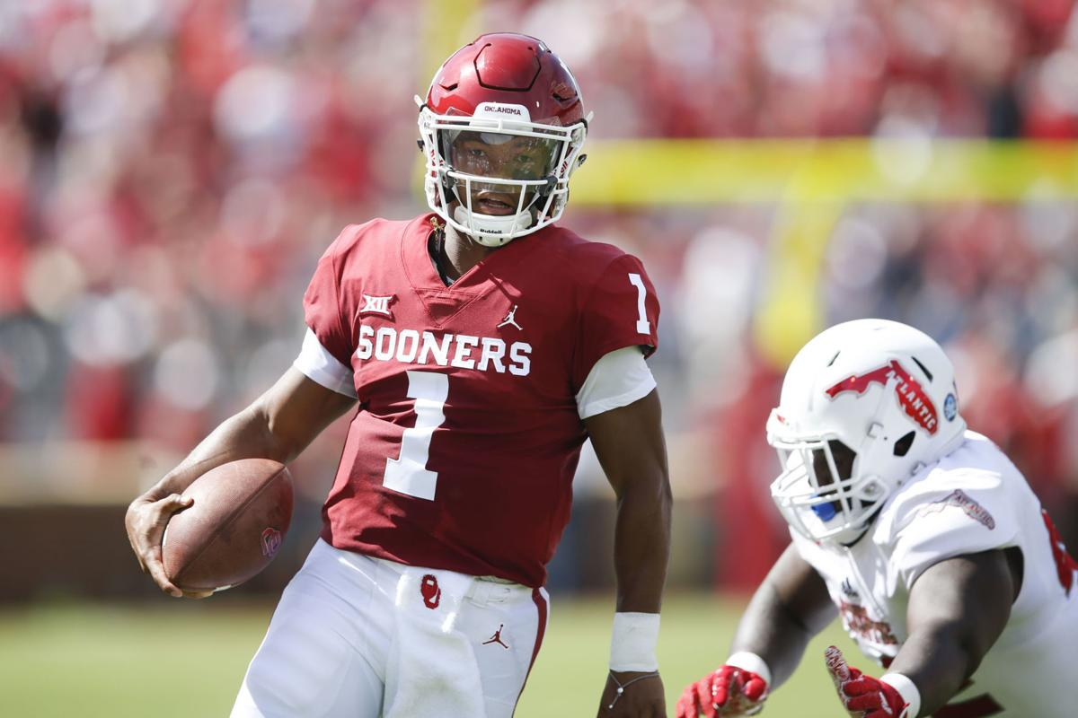 763dacc6 Oklahoma quarterback Kyler Murray (left) carries the ball against Florida  Atlantic on Saturday. Murray and the Sooners scored 42 first-half points on  the ...