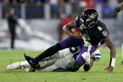 Lamar Jackson of the Baltimore Ravens rushes during the fourth quarter in a game against the Indianapolis Colts at M&T Bank Stadium on October 11, 2021 in Baltimore, Maryland.