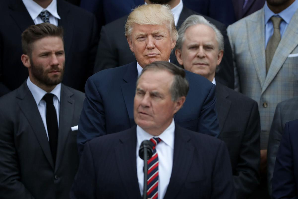 U.S. President Donald Trump, center, listens to New England Patriots Head Coach Bill Belichick deliver remarks during an event celebrating the team's Super Bowl win on the South Lawn at the White House April 19, 2017 in Washington, DC.