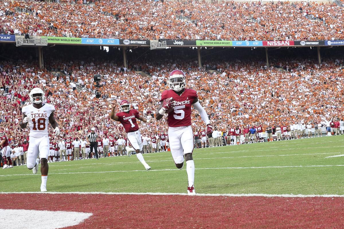 d37b9dda5 Oklahoma Sooners quarterback Kyler Murray (1) celebrates as Oklahoma  Sooners wide receiver Marquise Brown (5) walks into the end zone for a touchdown  during ...
