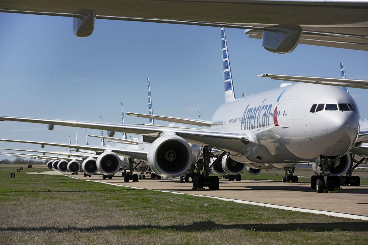 American Airlines planes sit idle on the runway at Tulsa International Airport