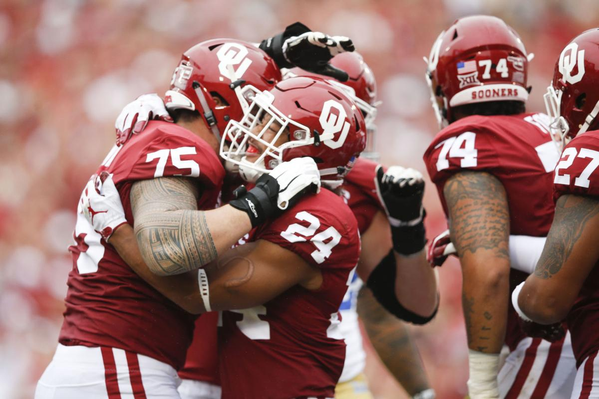 Oklahoma Sooners running back Rodney Anderson (24) celebrates with Oklahoma  Sooners offensive lineman Dru Samia (75) after scoring a touchdown during  the ... 10ea5cb61