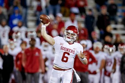 4e033319e Oklahoma Sooners quarterback Baker Mayfield (6) attempts a pass during the  NCAA football game between the Oklahoma Sooners and the Kansas Jayhawks at  ...