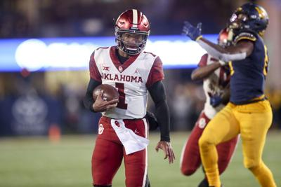 Oklahoma Sooners quarterback Kyler Murray (1) scrambles for a first down  during the NCAA football game between the Oklahoma Sooners and the West  Virginia ... 6880b3dc0