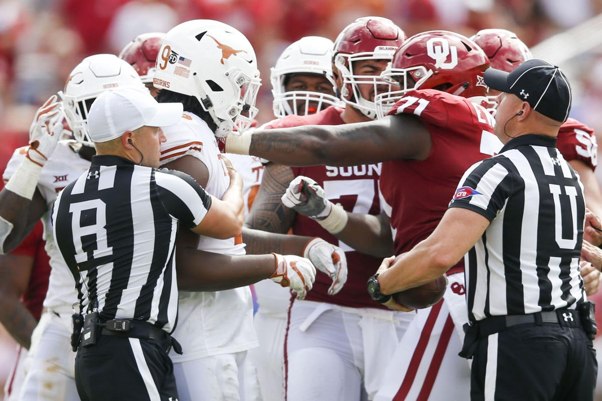 c5d8bfd56 Oklahoma offensive lineman Bobby Evans (right) shoves Texas defensive  lineman Ta Quon Graham after a play during the Sooners  loss to Texas in  the Red River ...