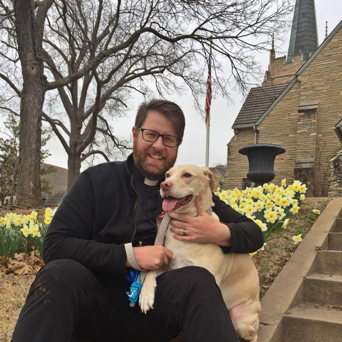 Father David Bumsted and his dog, named Cat.
