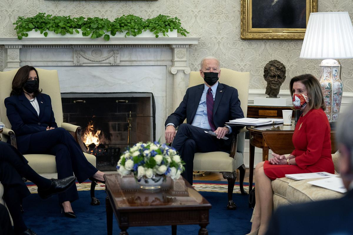U.S. President Joe Biden, center, and Vice President Kamala Harris, left, meet with House Democratic leaders, including Speaker of the House Nancy Pelosi, D- Calif., and committee chairs to discuss the coronavirus relief legislation in the Oval Office at the White House on Feb. 5, 2021, in Washington, D.C..