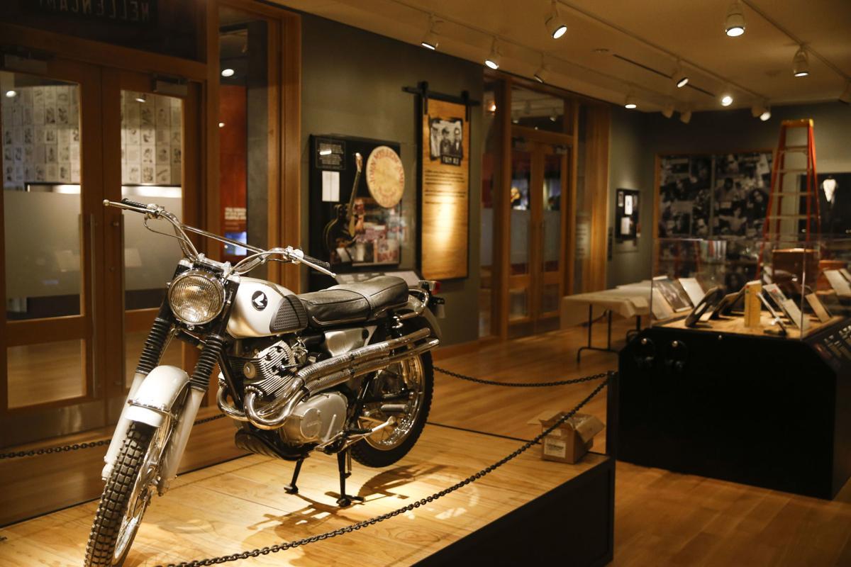 John Mellencamp\'s motorcycle, handwritten lyrics, instruments and ...