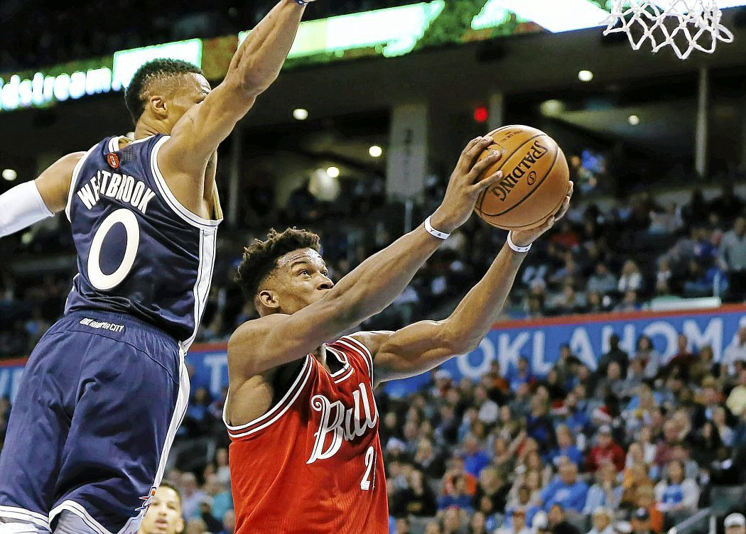 af141bb9e Chicago s Jimmy Butler (right) gets past OKC s Russell Westbrook during the Christmas  Day NBA basketball game between the Oklahoma City Thunder and Chicago ...