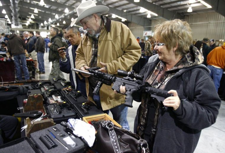 Tulsa gun show bustles as uncertainty about laws grows