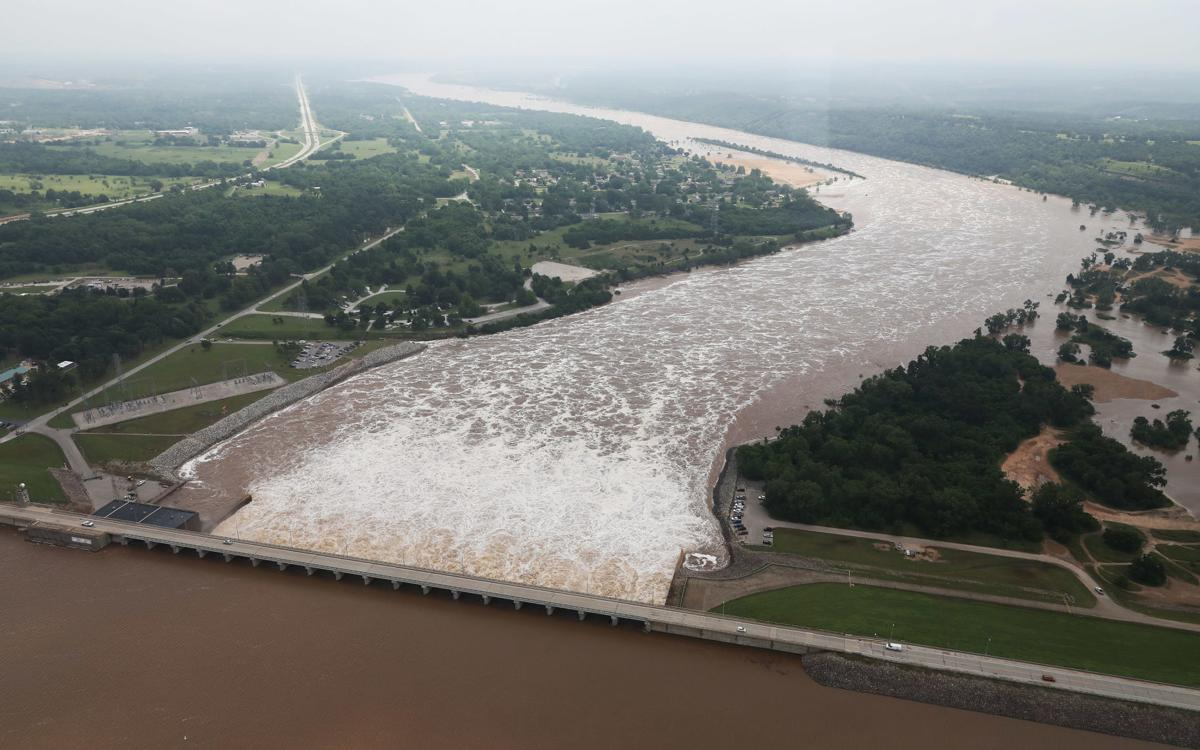 Arkansas River begins to recede as officials slowly reduce