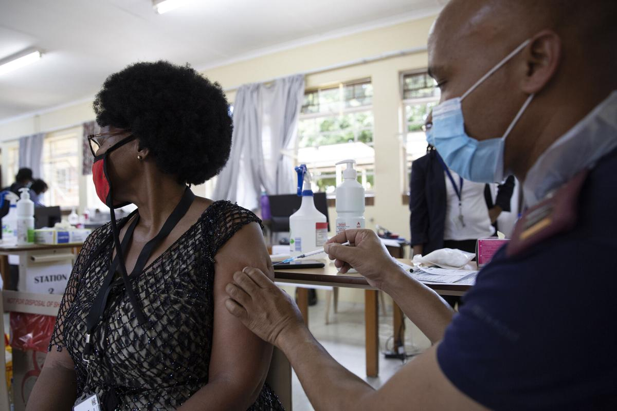 A health care worker looks away as she receives a dose of the Johnson& Johnson vaccine against the COVID-19 coronavirus as South Africa proceeds with its inoculation campaign at the Klerksdorp Hospital on Feb. 18, 2021.