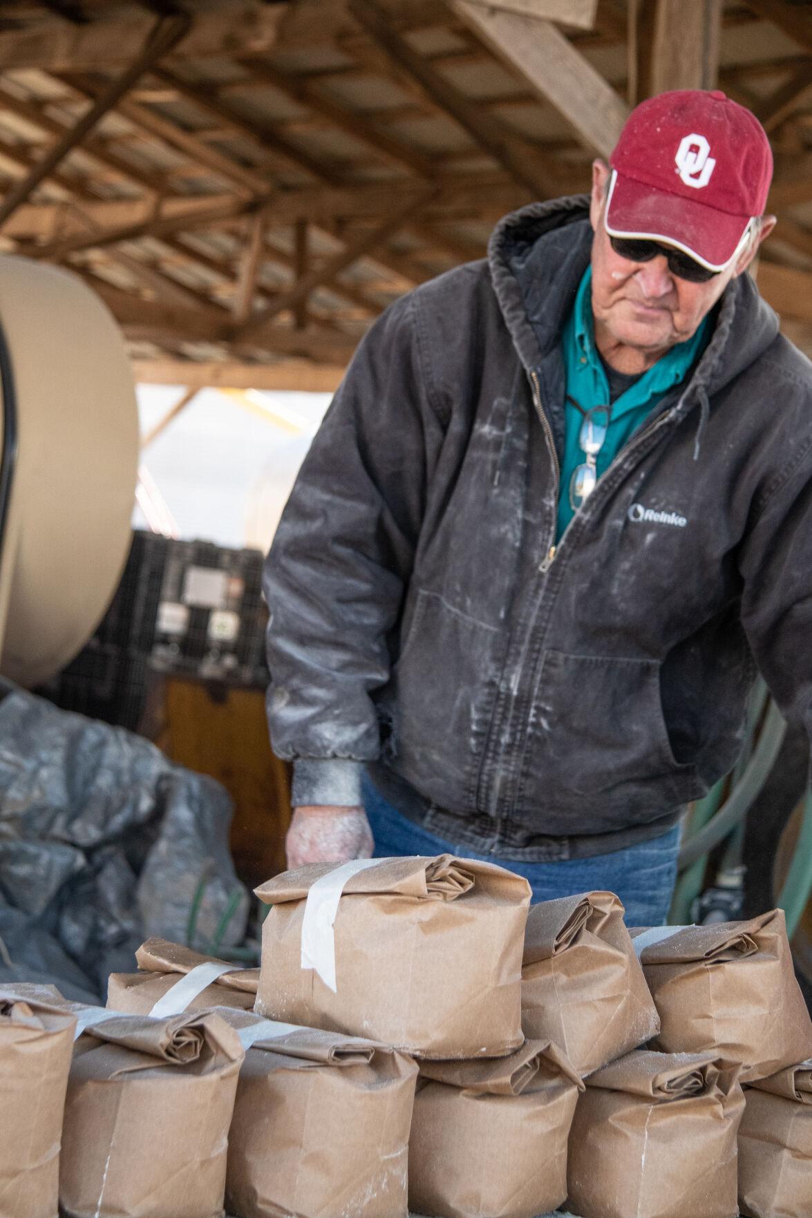 Charles Pearson bagging cornmeal