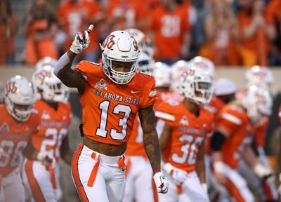 new arrival 02a16 4fd95 OSU football: Oklahoma State WR Tyron Johnson declares for ...