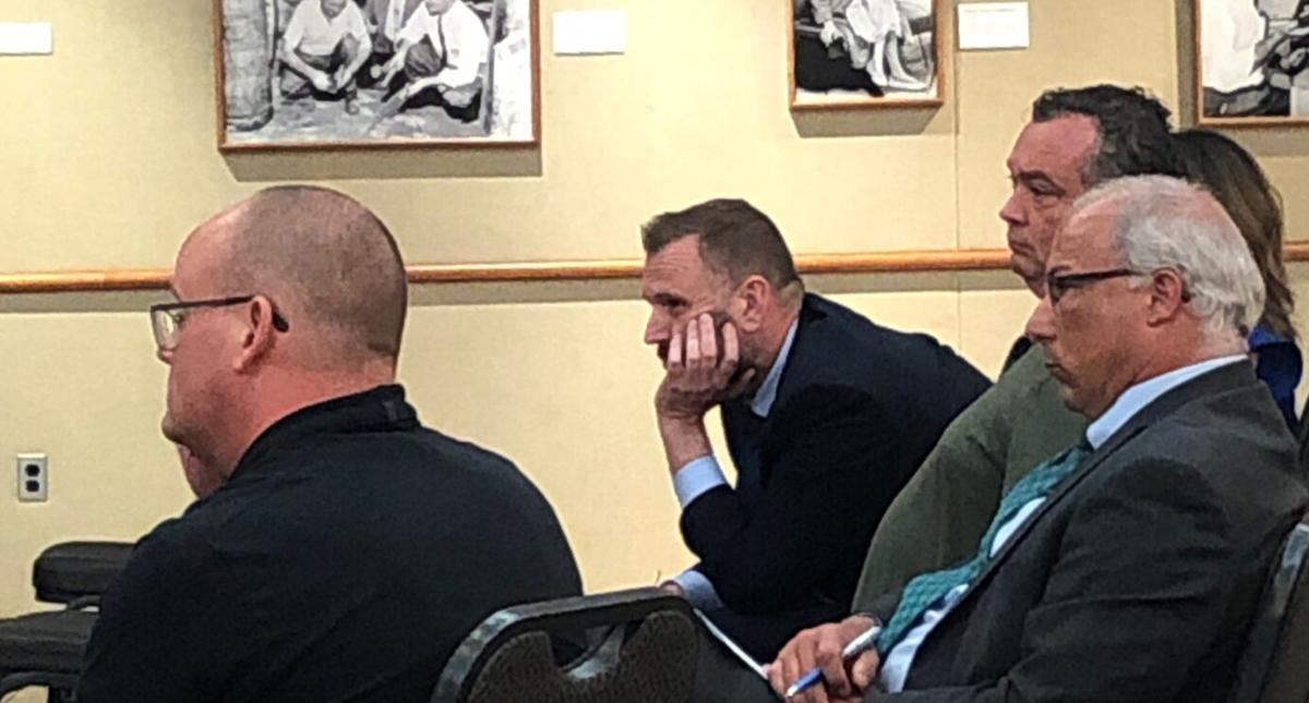 Epic officials react at Tuesday's Statewide Virtual Charter School Board meeting