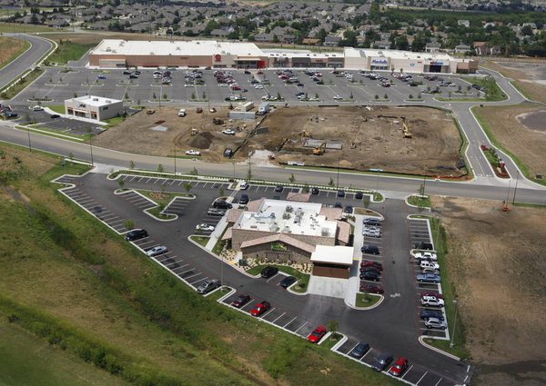 this aerial view near the broken arrow expressway and 71st street shows the new olive garden restaurant in the foreground and the shops at broken arrow in - Olive Garden Broken Arrow
