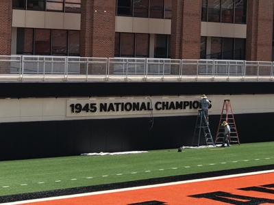 3a6b6437ede Oklahoma State places '1945 National Champions' sign at Boone ...