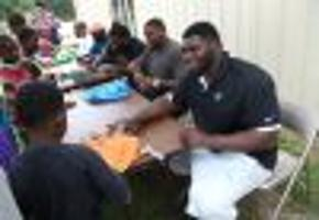 Hundreds come out in Muskogee as local NFL players give back