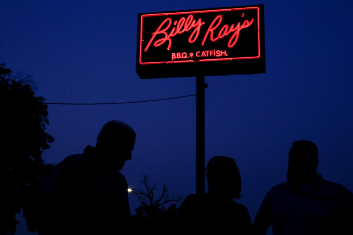 Red neon splendor again lights the way to Billy Ray's BBQ