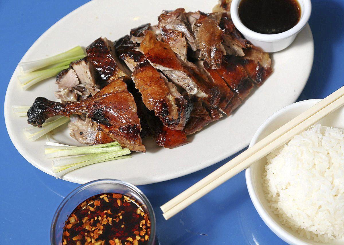 Review asian cuisine still offers impressive menu in new for Asian cuisine tulsa ok