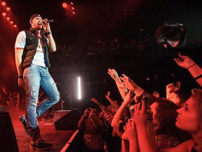 Why do some country singers seem embarrassed about their new songs?