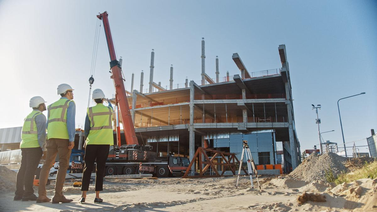 Diverse,Team,Of,Specialists,Inspect,Commercial,,Industrial,Building,Construction,Site.